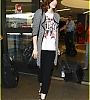 lily-collins-pushes-giant-luggage-cart-after-mortals-tour-05.jpg