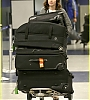 lily-collins-pushes-giant-luggage-cart-after-mortals-tour-06.jpg