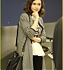 lily-collins-pushes-giant-luggage-cart-after-mortals-tour-07.jpg