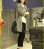 lily-collins-pushes-giant-luggage-cart-after-mortals-tour-08.jpg