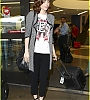 lily-collins-pushes-giant-luggage-cart-after-mortals-tour-09.jpg