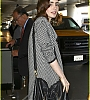lily-collins-pushes-giant-luggage-cart-after-mortals-tour-10.jpg
