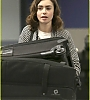 lily-collins-pushes-giant-luggage-cart-after-mortals-tour-11.jpg
