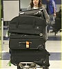 lily-collins-pushes-giant-luggage-cart-after-mortals-tour-12.jpg