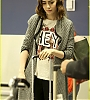 lily-collins-pushes-giant-luggage-cart-after-mortals-tour-13.jpg