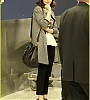 lily-collins-pushes-giant-luggage-cart-after-mortals-tour-14.jpg