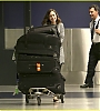 lily-collins-pushes-giant-luggage-cart-after-mortals-tour-16.jpg