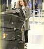 lily-collins-pushes-giant-luggage-cart-after-mortals-tour-17.jpg