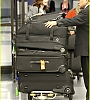 lily-collins-pushes-giant-luggage-cart-after-mortals-tour-19.jpg