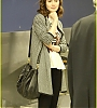 lily-collins-pushes-giant-luggage-cart-after-mortals-tour-21.jpg