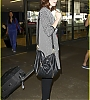 lily-collins-pushes-giant-luggage-cart-after-mortals-tour-22.jpg