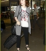 lily-collins-pushes-giant-luggage-cart-after-mortals-tour-23.jpg