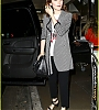lily-collins-pushes-giant-luggage-cart-after-mortals-tour-24.jpg