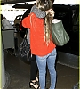 lily-collins-pushes-giant-luggage-cart-after-mortals-tour-25.jpg