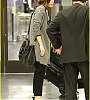 lily-collins-pushes-giant-luggage-cart-after-mortals-tour-26.jpg