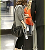 lily-collins-pushes-giant-luggage-cart-after-mortals-tour-27.jpg